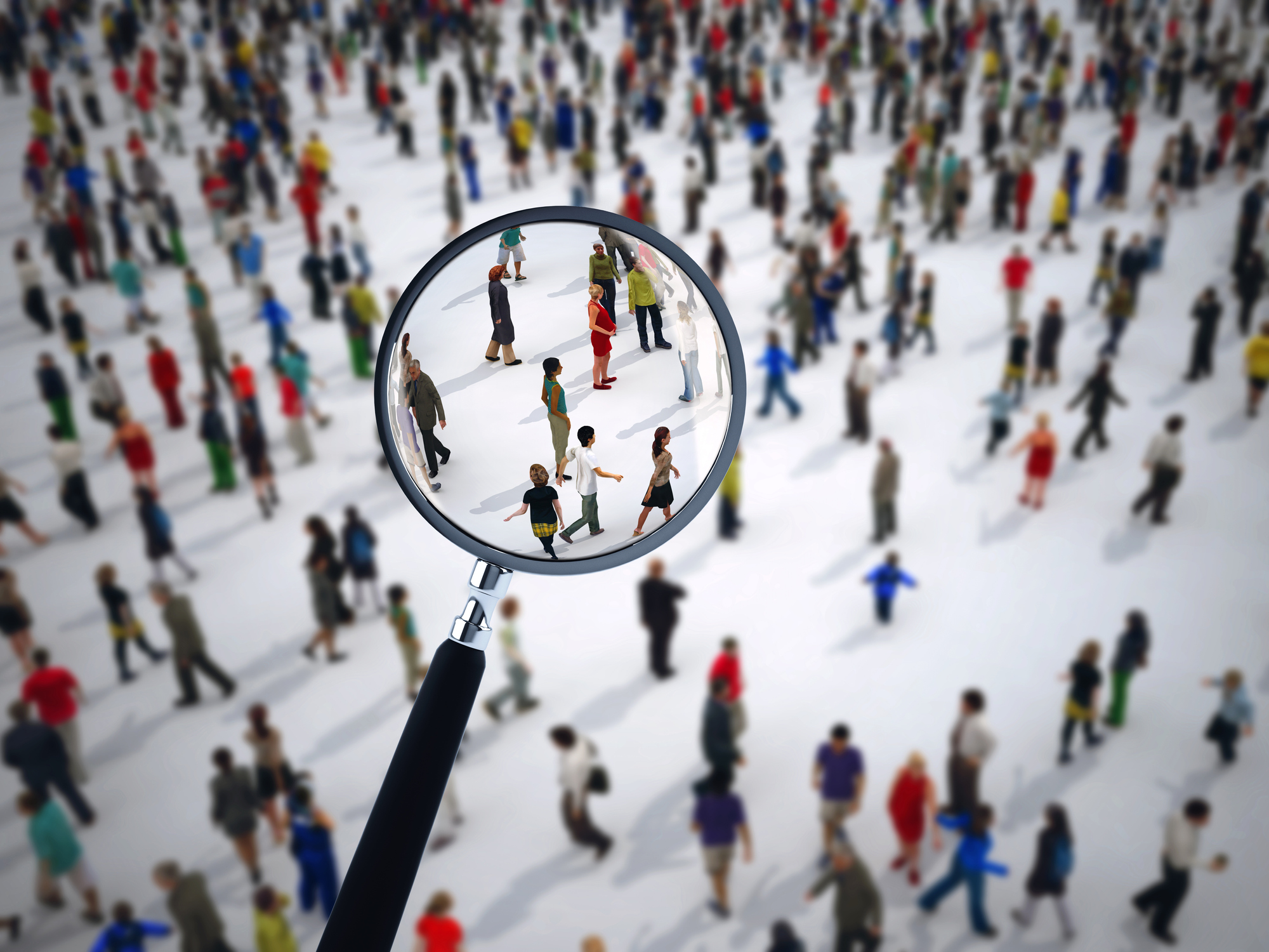 Magnifying glass on a large group of people